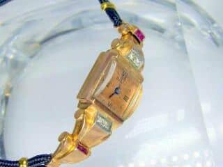 ダイヤとルビーをあしらったBULOVA (ブローバ)社製(鑑定書付)【商品番号1927】c